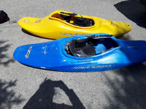 Sport kayak one yellow and one blue