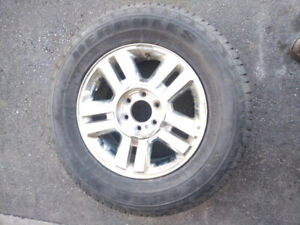"Ford F150 4x4 Aluminum rim with 18"" tire"