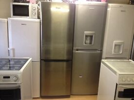 Silver fridge freezer with water dispenser