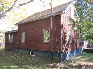 Deep River,Square timber log home on 3 acre tree lined property.
