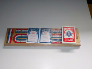 BRAND NEW Cribbage board still in the plastic packaging