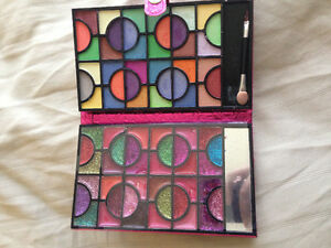 Multi coloured eyeshadow and lipstick palette