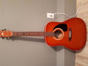Guitare sèche en très bonne etat 60$