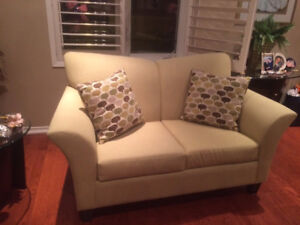 Mint green love seat with pillows