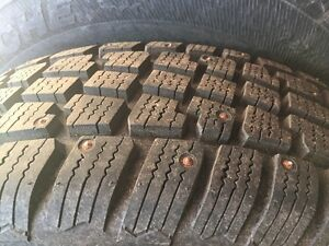 Set of winter studded tires on rims 225 65R17