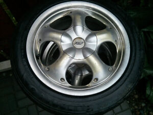 SET OF TIRES OR 2 SETS OF RIMS