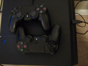 ps4 with games and 2 controllers