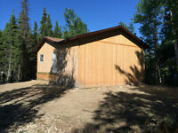 Lake Front Lot at Cranberry Portage with Lockup Cabin