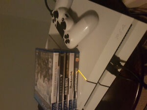 PS4 with controller and games