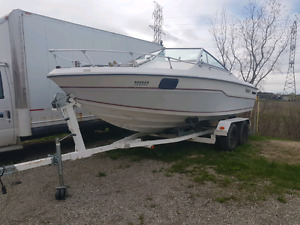 1989 21 footer Tempest Cuddy Cabin Boat and tamdem axel trailer
