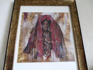 Deux tableaux style africaine avec l'encadrement noir et bronze