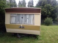 Atlas Solitaire 31ft x 10ft Caravan Off side Sell.