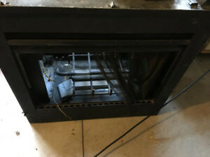 Parts from a HEAT-N-GLO Natural gas fireplace