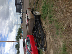 Truck bed trailer with deck