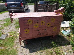 A rare find.  5x2 foot metal work bench on wheels.
