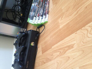 XBox 360 with two controllers and games