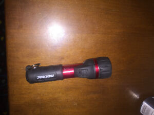 Rayovac red black white flashlight