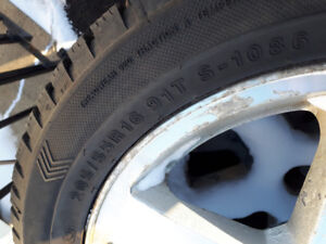 4 studded snow tires on rims