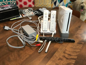 For Sale: Wii console, 4 games, 2 guitars