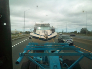 Have a boat with no trailer get it towed by us most boats $450
