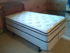As new Spring wall pillow top Twin size bed ,mattress and boxspr