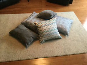 Five silver toned throw cushions
