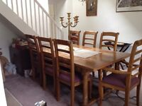 Oak table with slate inlay 8 chairs (including 2 carvers)