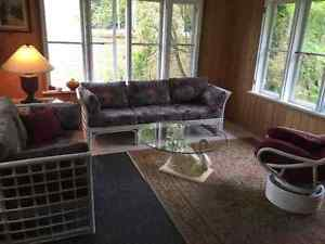 rattan sunroom fyrniture with swan glass coffee table and glassp