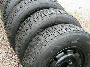 4 firestone winter force studded tires on 01-7 caravan rims.$180