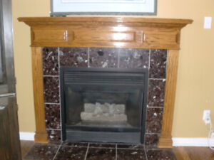 3 piece OAK MANTEL ( 64 inches by 41.5 (top of mantel)