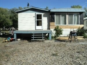 3 TREED LOTS-DOUBLE GARAGE-4 BR. MOBILE-GUERNSEY,SK