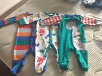 Several bundles of 0-3 month clothes
