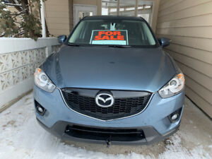 2015 blue Mazda CX-5 * under 23,000 kms*