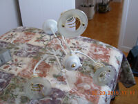 White delicate 3 bulb dining room light fixture,gently used,nosm