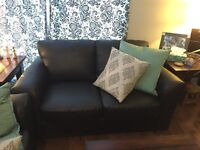 Black couch and loveseat