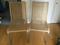Pair of wicker style dining chairs