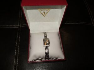 New Authentic GUESS watch - Ladies with stones around the face