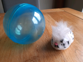 Toy pet hamster and ball