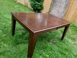 Dining room table with removable leaf