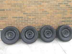 Snow tires and rims 215/55R16 Windsor Region Ontario image 1