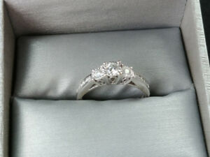 White gold engagement ring and wedding bands
