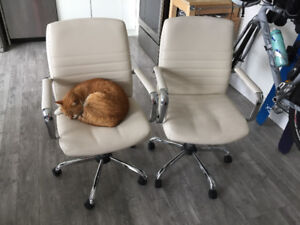 Two White Vinyl Leather Office Chairs