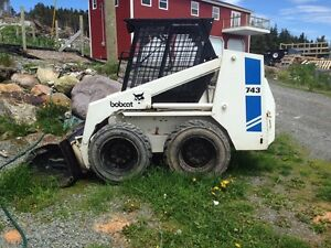 1988 Bobcat 743! Low hours and comes with new Post Hole Auger.