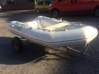 Fibreglass hull blow up rib on trailer with oars boat tender