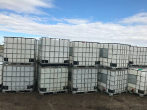 275 gallon plastic water tanks mounted on a wooden pallet