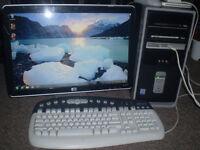 COMAPQ desktop with 19 inch HP LCD monitor