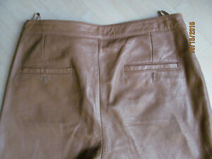 LEATHER Pants size 12 . LEATHER SKIRT size 14.