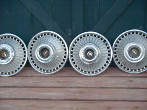 "SET OF FOUR""CHEV"" WHEEL DISC'S"