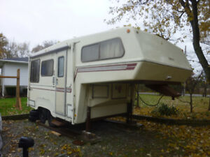 SOLD pending delivery... Bigfoot 21 ft 5th wheel camper trailer