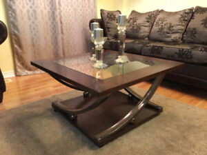 Dark Wooden Coffee Table With Glass Panel and Curved Metal Legs